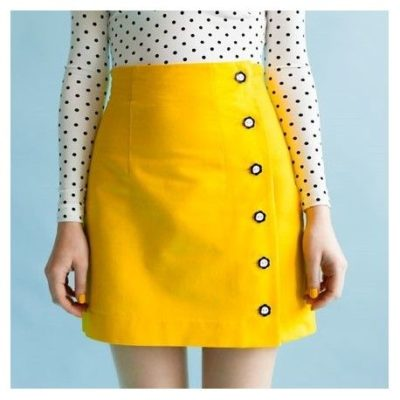 Arielle is an asymmetric pencil or mini skirt with an adorable button opening to one side. Long darts and a high waistline create a
