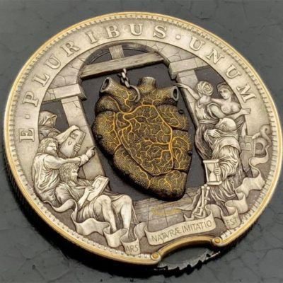 Exquisitely engineered coin contains a mechanical beating heart